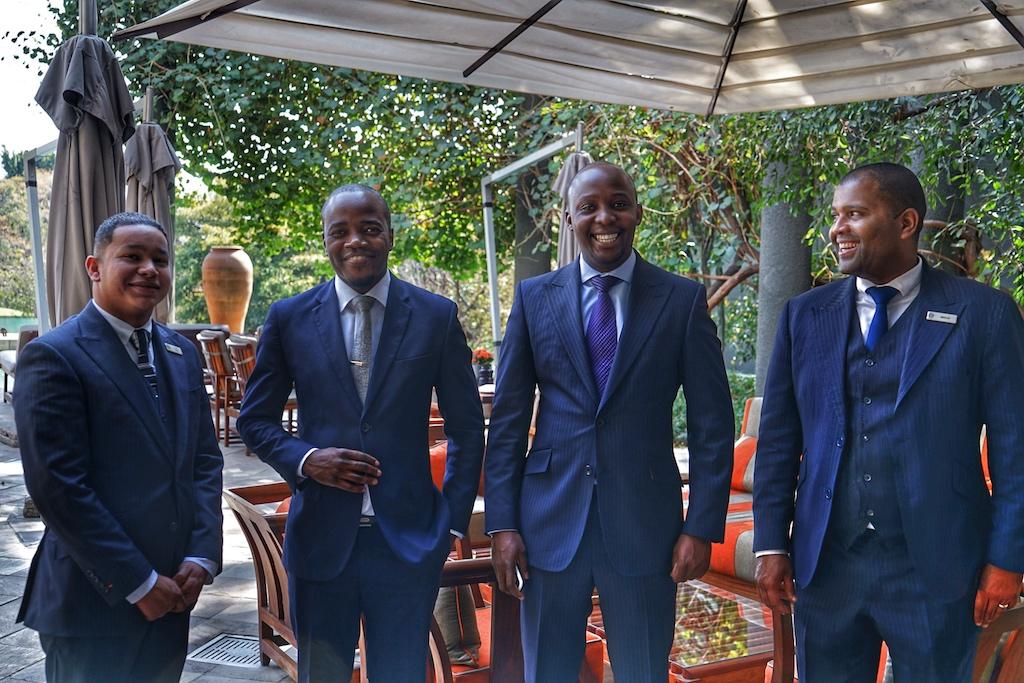 Die führenden Mitarbeiter haben sich gerne für ein Foto positioniert. Von links nach rechts: Ashwin Ryan, Lloyd Jusa, Justin Mugwaneza und Sinclair Mnguni